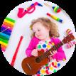 little girl playing guitar